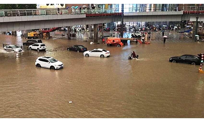 चीन में बारिश और बाढ़ का कहर, 12 लोगों की मौत